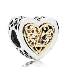 In a nod to the romance of times past, this detailed two-tone charm features delicate 14K yellow gold filigree hearts in a sterling silver bezel. Wear it to add a touch of luxury to your bracelet.<br> <br>  <b> Style: </b> 791740