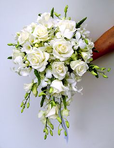 All white cascade bouquet with roses and dendrobium orchids add tulips Save money by sending flowers directly with a Local Florist. But with peonies Cascading Bridal Bouquets, Cascading Wedding Bouquets, Cascade Bouquet, Bride Bouquets, Bridal Flowers, Flower Bouquet Wedding, Floral Bouquets, Floral Wedding, White Orchid Bouquet