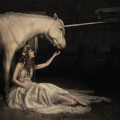 STORY PROMPT: What is the relationship between the woman and the unicorn? How did they meet? What journey are they on together?