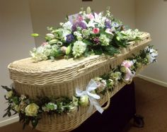 Cream willow coffin with natural garden flowers. Garland and posies. Flowers by The Manchester Florist. Coffin from www.naturalendings.co.uk