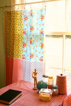 cottage kitchen, curtains from Fat Quarters. oil cloth tablecloth
