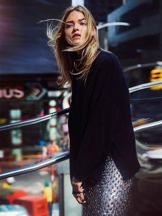 Martha Hunt wears Tibi sweater with Michael Kors Collection skirt