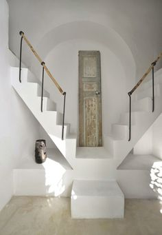 Whitewashed walls and a double staircase | Marion Martin's summer home in Tunisia