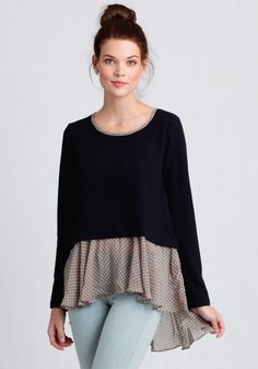 Cute and cozy, this navy sweater features a textured houndstooth design, a relaxed fit, and high-low hem.