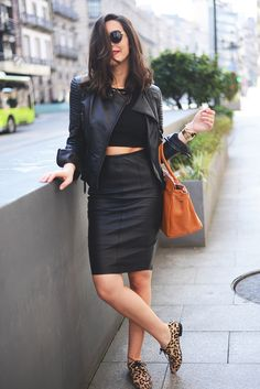 Shop this look for $108:  http://lookastic.com/women/looks/jacket-and-cropped-top-and-pencil-skirt-and-shopper-handbag-and-brogues/1616  — Black Leather Jacket  — Black Cropped Top  — Black Leather Pencil Skirt  — Tobacco Leather Shopper Handbag  — Tan Leopard Brogues