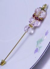 Pink and gold hat pin
