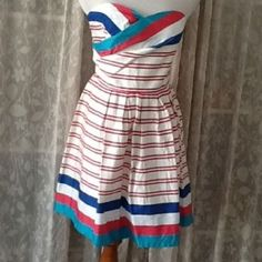 Fun summer dress Super cute summer dress perfect for a fun day of events or even a more formal event. Super comfy and looks great on! 2nd-4th photo are actual product Charlotte Russe Dresses Strapless