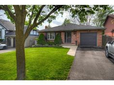 1023 SHERBOURNE - Absolutely mint all brick bungalow with attached single car garage and double drive located on quiet street in North London. CALL TEAM O'HALLORAN, Sales Representatives 519.673.3390