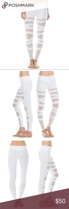 "🆕 Ballerina Mesh Panel Bandage Leggings White sheer mesh panels cross up the legs of these stretch active leggings. Features: banded waist, mesh panel insets, inside waistband hidden key pocket, & lace up bandage look. Small Measures: 8"" rise, 28"" inseam. Electric Yoga Pants Leggings"