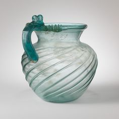 Glass jug,Early to Mid Imperial late 1st–2nd century A.D.Roman.Glass; blown in a dip mold and tooled.The Met image.