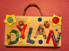 Hand decorated and bespoke name plaques.