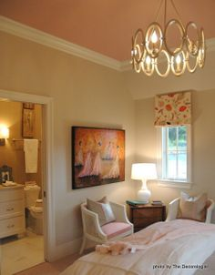 Love this! Sherwin Williams' Accessible Beige on the walls, Oyster White on the trim, and Gracious Rose on the ceiling.