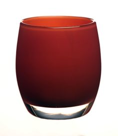 joy is a cranberry red handmade glass candle holder or vase.  Very holiday and a gift for Christmas.