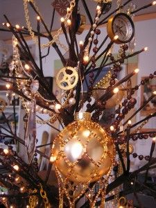 in the center of each table, have a small bare tree in the middle, cover it with lights n gears n clocks, like above