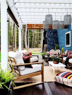 A New Hampshire A-Frame Cabin Packs Eclectic Style Into a Tiny Space New Hampshire, A Frame Cabin, A Frame House, Boho Chic, Bohemian, Small Space Living, Small Spaces, Colorful Furniture, Outdoor Furniture Sets