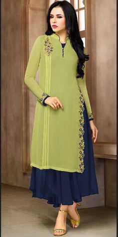 Flamboyant light green and navy blue georgette ceremonial wear embroidered kurti. Having fabric georgette and santoon. The thread work, embroidery work and resham embroidery work seems chic and great for any party. Kurti Designs Party Wear, Kurta Designs, Blouse Designs, Stylish Dresses, Casual Dresses, Fashion Dresses, Pakistani Dresses, Indian Dresses, Eid Dresses