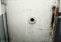 """Mauthausen. The """"Judas Opening"""".  A peephole in the door of the gas chamber, through which guards and V.I.P.s could enjoy watching the death agonies of their helpless, defenseless victims.   What dark, wicked things were witnessed through this window are too ghastly to dwell upon."""