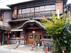 The entrance to the machiya restaurant Sarasa Nishijin, a former bathhouse in Kyoto, Japan. Featured in Kyoto Machiya Restaurant Guide by Judith Clancy, with photographs by Ben Simmons