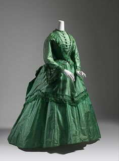 Dress Date: ca. 1870 Culture: British Medium: silk Dimensions: Length at CB (a): 21 1/2 in. (54.6 cm) Length at CB (b): 46 in. (116.8 cm) Length at CB (c): 31 1/2 in. (80 cm) Credit Line: Catharine Breyer Van Bomel Foundation Fund, 1980