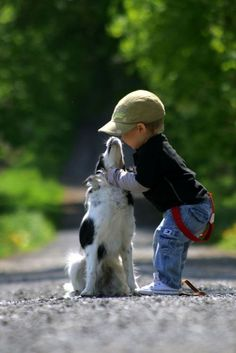 a little boy with his puppy
