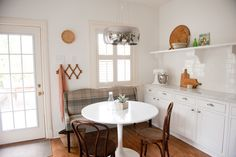 At the Table    This small settee works like a built-in bench but is more versatile.
