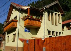 Pension Gentiana Sibiel Located next to the beautiful Cindrel Mountains, Pension Gentiana features bright rooms with free Wi-Fi, and a terrace with tables and chairs. Sibel town centre is just 600 metres away. Bright Rooms, Terrace, Shed, Outdoor Structures, Cabin, House Styles, Wi Fi, Outdoor Decor, Centre