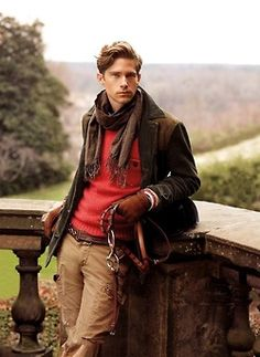 English country. Love the riding boots. Red for pop of color. Hunter green and plaid scarf