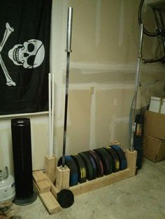 DIY Bumper Plate and Barbell Storage.  (photo only)