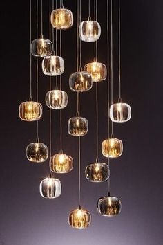 CUBIE Pendant Light — Best Goodie Shop - These Light Pendants features Amber, Smoke, or Clear hand-molded crystal shades with a Chrome finish. Special forming and cutting artistry is used to achieve the curvature frame of this drop Interior Lighting, Home Lighting, Lighting Design, Suspended Lighting, Pendant Lighting, Room Lights, Ceiling Lights, Entryway Chandelier, Deco Luminaire