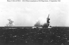 "USS O'Brien (DD-415) is torpedoed by Japanese submarine I-19 during the Guadalcanal Campaign, 15 September 1942. USS Wasp (CV-7), torpedoed a few minutes earlier, is burning in the left distance. O'Brien was hit in the extreme bow, but ""whipping"" from the torpedo explosion caused serious damage to her hull amidships, leading to her loss on 19 October 1942, while she was en route back to the United States for repairs."