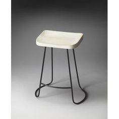 Alton Bar Stool - Butler Specialty 1839290 The intriguing lines of the black wrought-iron base provide the perfect complement to the white-washed finish on the sculpted solid mango wood seat, ensuring this Bar Stool is as stylish as it is practical.
