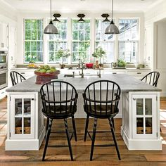 """Kitchen - 2015 Charlottesville Idea House Tour - Southernliving. Bunny says, """"When creating a classic white kitchen, be careful with the shade. It can't seem stark—it needs to be a nice warm white."""" Rosney Co. modernized the typical rambling farmhouse floor plan with an open kitchen in the center of the home. """"There's no formal dining room in the house, just the eating area in the kitchen, which opens to the porches,"""" they explain."""
