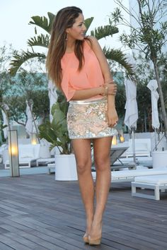 coral colored shirt and glitter skirt