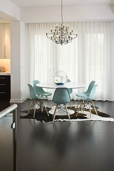 Love the simplicity of the chairs and table. The chandelier was a great finishing touch