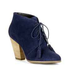 Lace-up ankle booties in navy suede with fun, on-trend tassels and a stacked heel