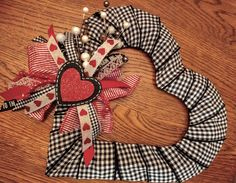 Dollar Tree wire wreath form wrapped in ribbon.  Farmhouse Valentine Black and red Valentine Valentine Wreaths Heart Shaped Wreath