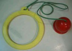 Do you remember Footsie? You put the yellow ring around your ankle and made it go in circles, jumping over the rope and bell. It was a simple toy but fun! I could never get it to go fast but I remember my footsie too My Childhood Memories, Childhood Toys, Great Memories, 1970s Childhood, Cherished Memories, Summer Memories, School Memories, Retro Toys, 1960s Toys