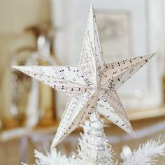 Musical Star Tree Topper Star tree toppers are always popular. Give yours a twist of style by covering it with strips of Christmas carol sheet music and outline it with glitter. Pretty Christmas Trees, Christmas Tree Toppers, All Things Christmas, Winter Christmas, Christmas Holidays, Christmas Decorations, Christmas Ornaments, Christmas Star, Christmas Carol