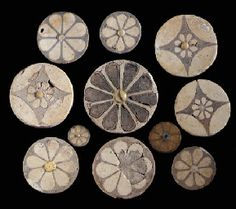 ELEVEN EGYPTIAN FAIENCE ROSETTE INLAYS