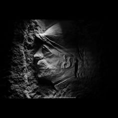 Photo by Jeff Gusky @hiddenwwi | This stone carving of a French officer has been hidden in complete darkness for a hundred years under a rural farm field in northern France in a former WWI underground city. The underground city began as a vast stone quarry mined hundreds of years before WWI for limestone blocks to build castles cathedrals fortresses and homes. Its over one hundred acres underground and takes hours to see. When WWI came along armies on both sides converted the space to a…