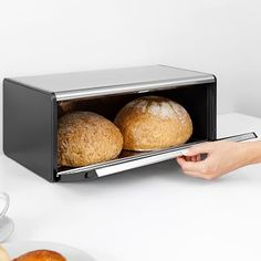 Brabantia products are sustainable, smart and well made. With its magnetic seal to preserve freshness for up to two loaves, this bread box can also hold your kitchen items on top of its flat top to save space. Kitchen Canisters, Kitchen Items, Kitchen Storage, Kitchen Retro, Bread Drawer, How To Store Bread, Bread Bags, Types Of Bread, Food Storage Containers