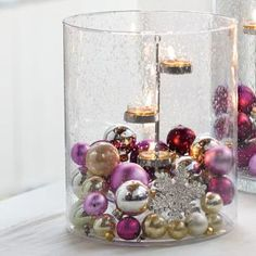 """Grand Hurricane - Styled after our popular Majestic Hurricane, but with a new smaller size and raised flat bottom. Mouth-blown seed glass radiates with character and charm when lit by candlelight. Includes a Silver-tone Universal Tealight Tree. 10¾""""h, 8¾""""dia."""