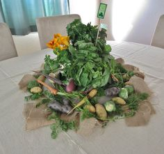 The $8 St. Patrick's Day table centerpiece with potatoes, carrots, and herbs
