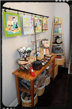 Using a curtain rod and rings to display art/pictures is so genius.  I am so doing this for my daughter's room when she starts making art.