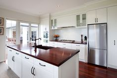 Jarrah benchtops are the ideal complement to the classic white finish and colonial detail of this American inspired kitchen.