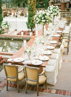 drooling over this elegant tablescape with raised centerpieces.