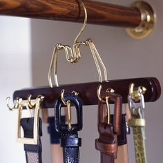 Portable Hooks  To create a belt rack that matches your other hangers (and doesn't require making holds in the wall), try this: Use Portable Hooks on a wood hanger.
