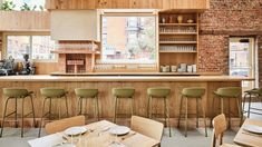 Elevated planting, earthy tones and natural materials are all found inside a restaurant designed by New York studio Carpenter + Mason in Brooklyn's Greenpoint neighbourhood.