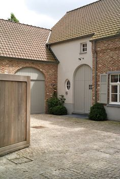 The Paper Mulberry: Exterior Paint Shades - Chalky hues of French Grey - Gray with Brick I like the grey for the new house. Exterior Paint Colors For House, Paint Colors For Home, Cottage Exterior Colors, Rendered Houses, Grey Woodwork, Pintura Exterior, Casa Patio, Stucco Homes, Brick Colors