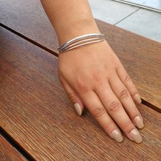 Sterling Silver Collection 925 Sterling Silver 8.5mm wide band and 2 1/4 inches inside the cuff 11.45Grams Free shipping in Continental USA Free gift box and jewelry pouch The artistically unique style of the sterling silver linear waves cuff bracelet is a work of art in its own right.Sterling silver in a high mirror polish,8..5mm wide cuff, measuring 2 1/4 inches on the inside dimension. The braceletisstreamlined, comfortable and an excellent day-to-night jewelry option. I...